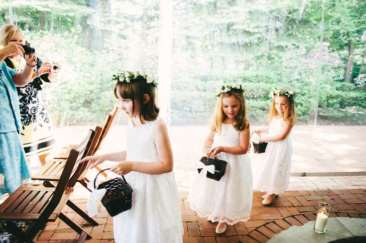 The 5-year-old flower girls wore flower crowns and simple white dresses, going with the free-spirited bohemian theme. They carried baskets of dried coral roses and scattered the petals as they walked single file down the aisle.