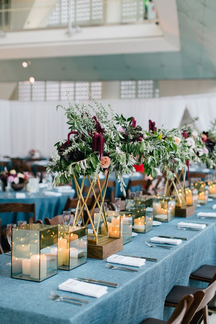 Reception Tables with Blue Linens, Candles and Tall Floral Centerpieces