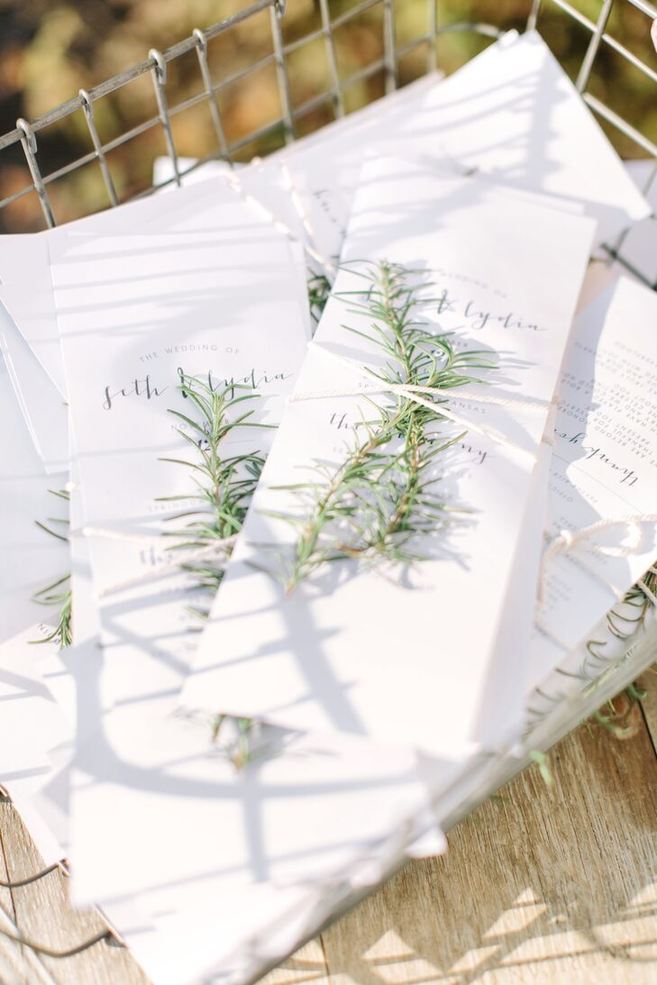 "Lydia designed her own affordable  invitations with the help of a coworker. ""I tied rosemary sprigs from a friend's garden onto the wedding programs,"" she says."