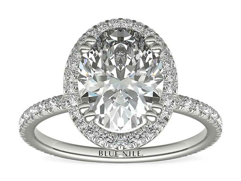 Oval-cut engagement ring with diamond halo