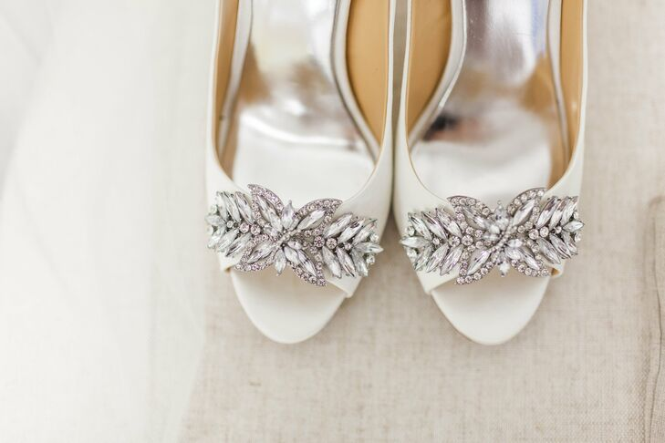 "The bride wore peep-toe Badgley Mischka heels with a crystal detail. ""So painful, but so worth it!"""