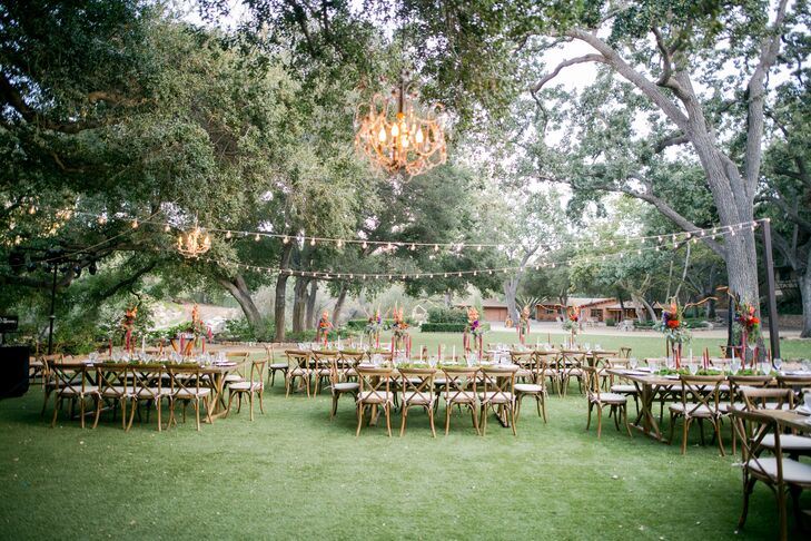 "String lights and chandeliers added warmth and glamour to the outdoor reception. ""We added touches of gold in brass candleholders and chargers,"" Lisa says. ""We truly felt that this wedding was going to be a dream come true, and it was. It was the epitome of rustic elegance."""