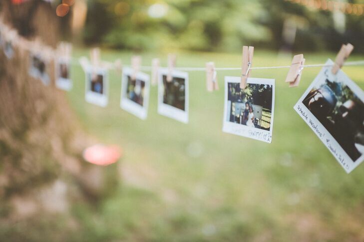 "In addition to the vintage key tags for guests to share tips for a happy marriage, Caroline and Michael had a photo booth during the reception where guests could snap pictures and share their well-wishes for the newlyweds. ""Our photo booth was neat—we have so many big trees in my parents' backyard that we put a string from one end to the other and hung Polaroids people took,"" Caroline says. ""They signed their names and some put marriage advice. This saved us a heck of a lot of money as opposed to a traditional photo booth."""