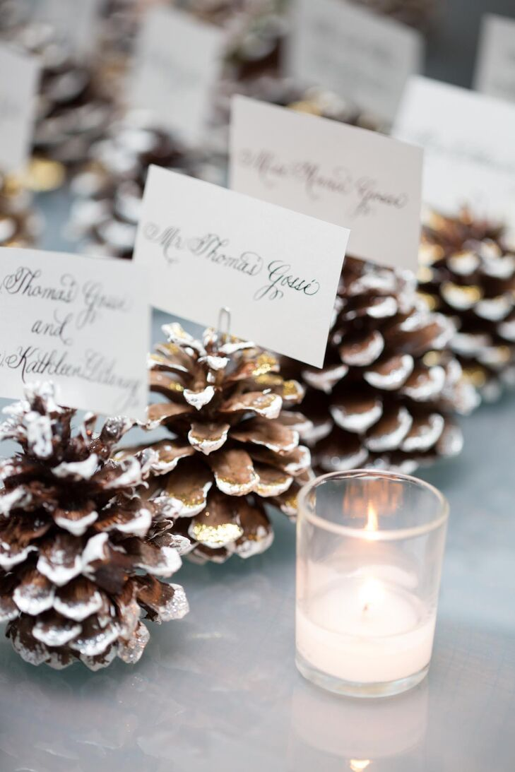 Guests found their escort cards displayed on pinecones at the guest table. The small pinecones were painted white at the edges to make them look like they were dusted in snow. This added a nice wintry touch to Karen and Jake's January wedding without going overboard on the seasonal theme.