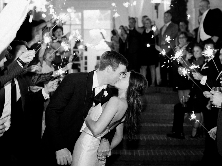 Wedding reception kiss and exit