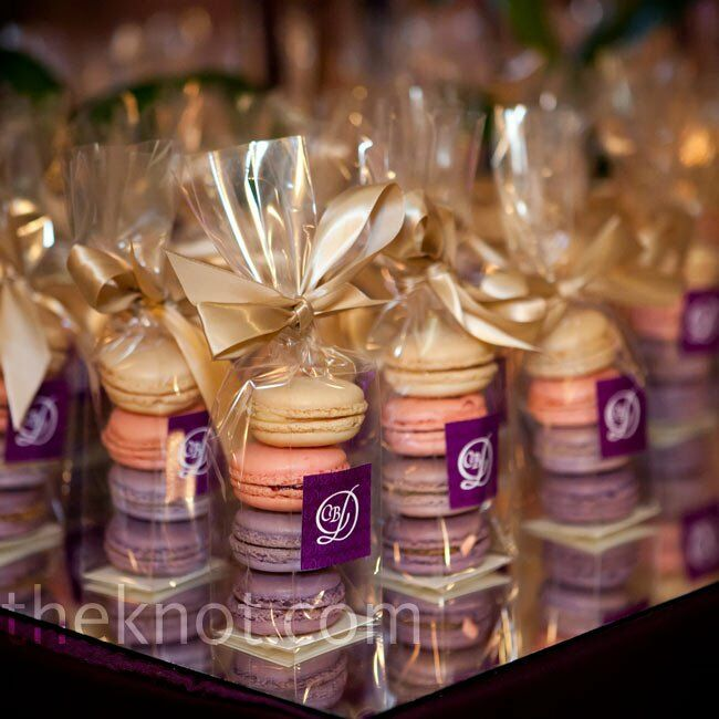 Guests took home multicolored macarons elegantly packaged with light gold ribbon.