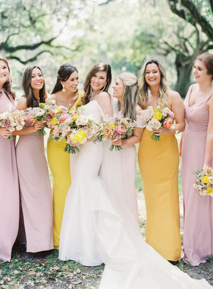 Yellow and Purple Bridesmaids Dresses and Colorful Bouquets