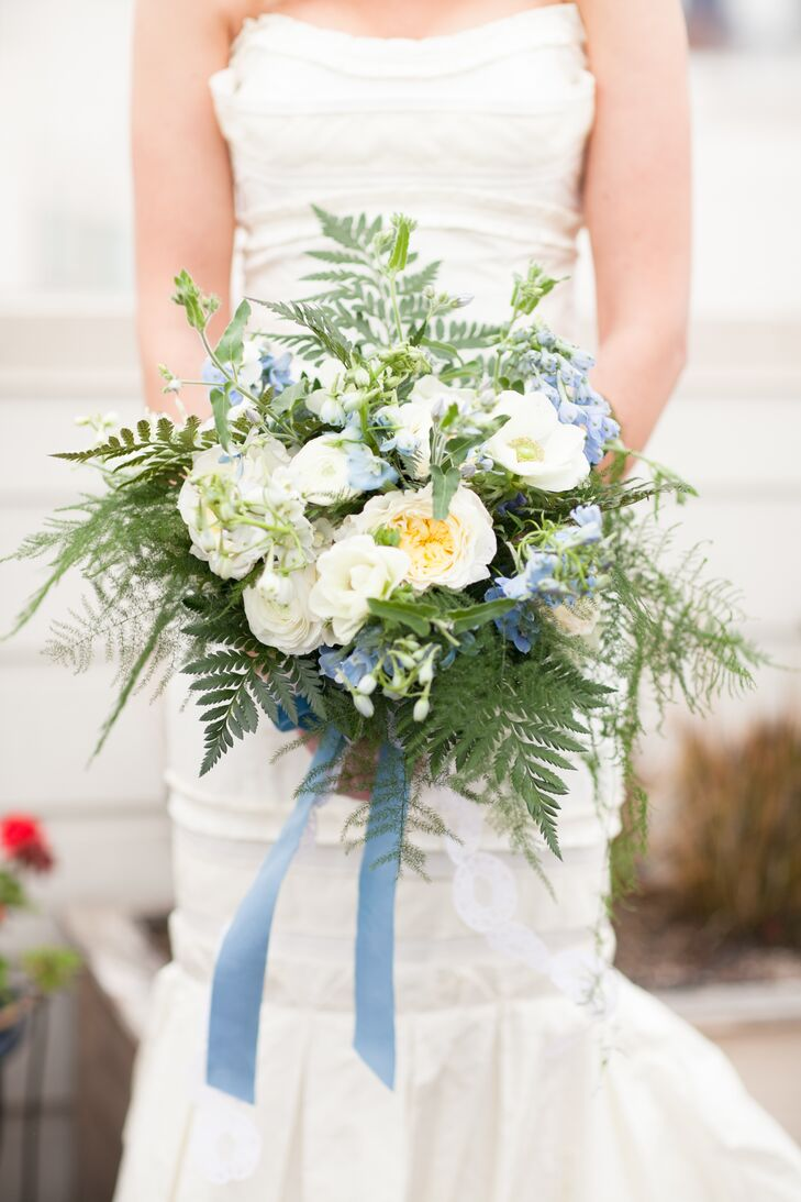 Since Lauren has always had a soft-spot for blue hydrangea, that became the starting point for her romantic bouquet. Her florist added white anemones, plumosa ferns and large rose blooms and found a pale blue velvet ribbon to wrap the stems.
