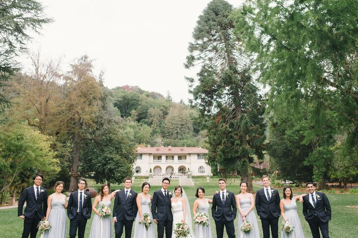 Jauchy's bridesmaids wore pale, slate blue gowns, and Jeffrey's groomsmen sported navy J.Crew suits.