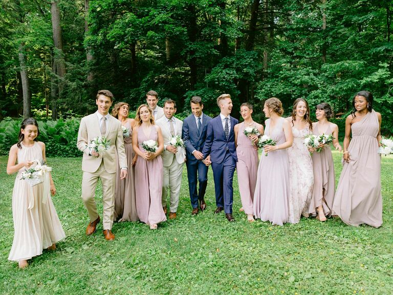 Grooms with wedding party members in light, airy fabrics for summer wedding