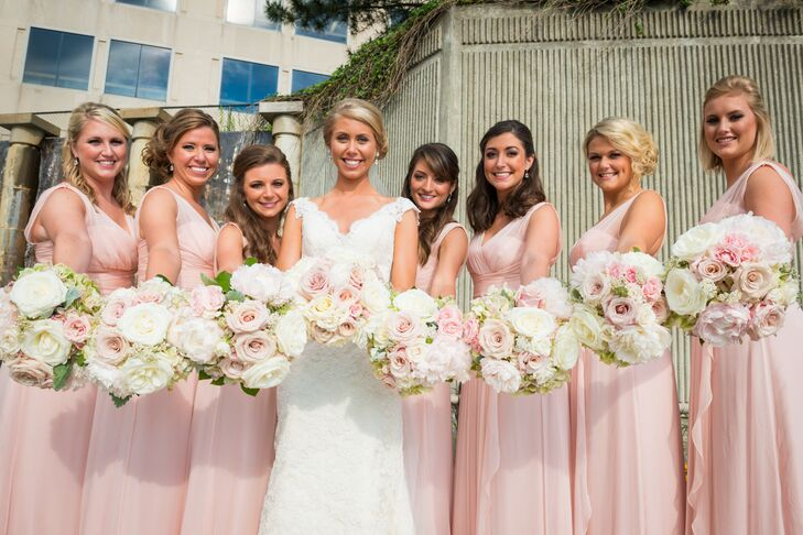 Jillian's bridesmaids wore floor-length dresses in blush, which they bought from Bella Bridesmaids. They carried ivory and blush bouquets with roses and peonies.