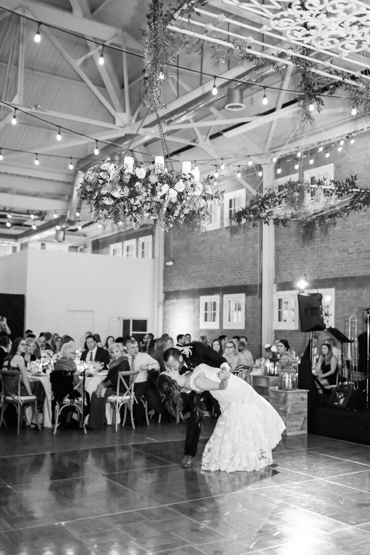 Floral chandeliers by Flowers Annette Gomez brought a touch of romance to the indoor reception at Brick in Liberty Station in San Diego, California.