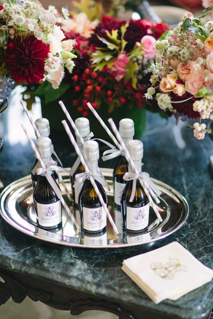 During bridal party prep, bridesmaids were offered mini champagne bottles with straws.