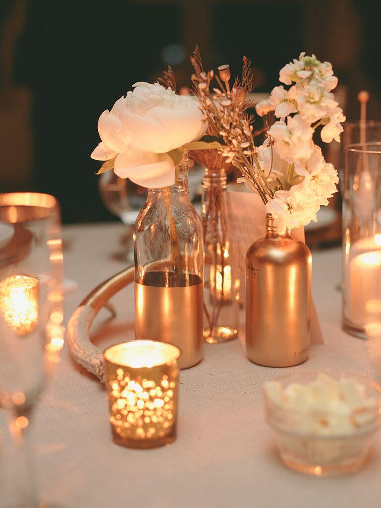 Gold mismatched vases for wedding reception table