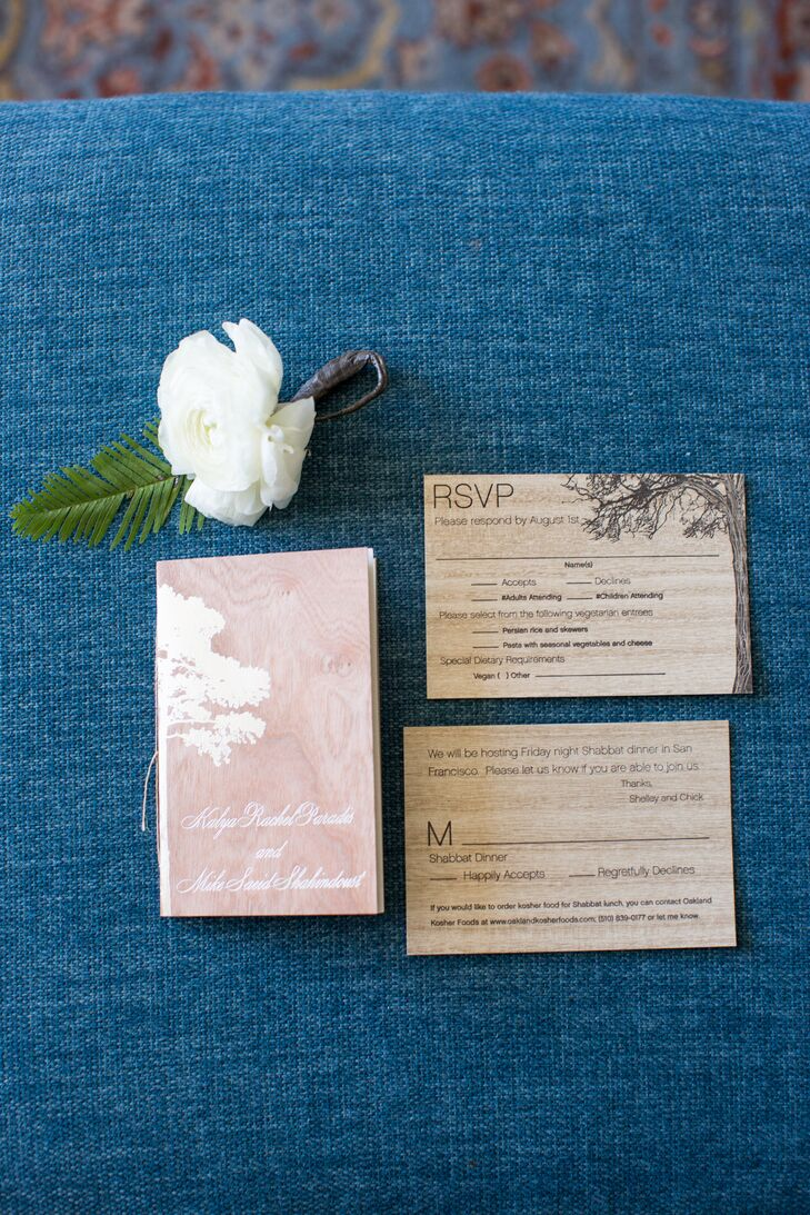 The invitations were simple, tiny booklets with covers made of thin, lightweight wood.
