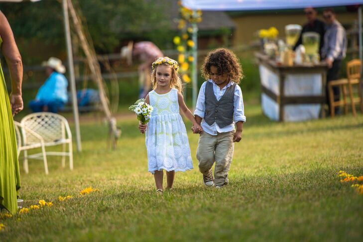 4bc6f0b8e6f The flower girl wore a yellow green dress with a white sunflower-patterned  lace overlay