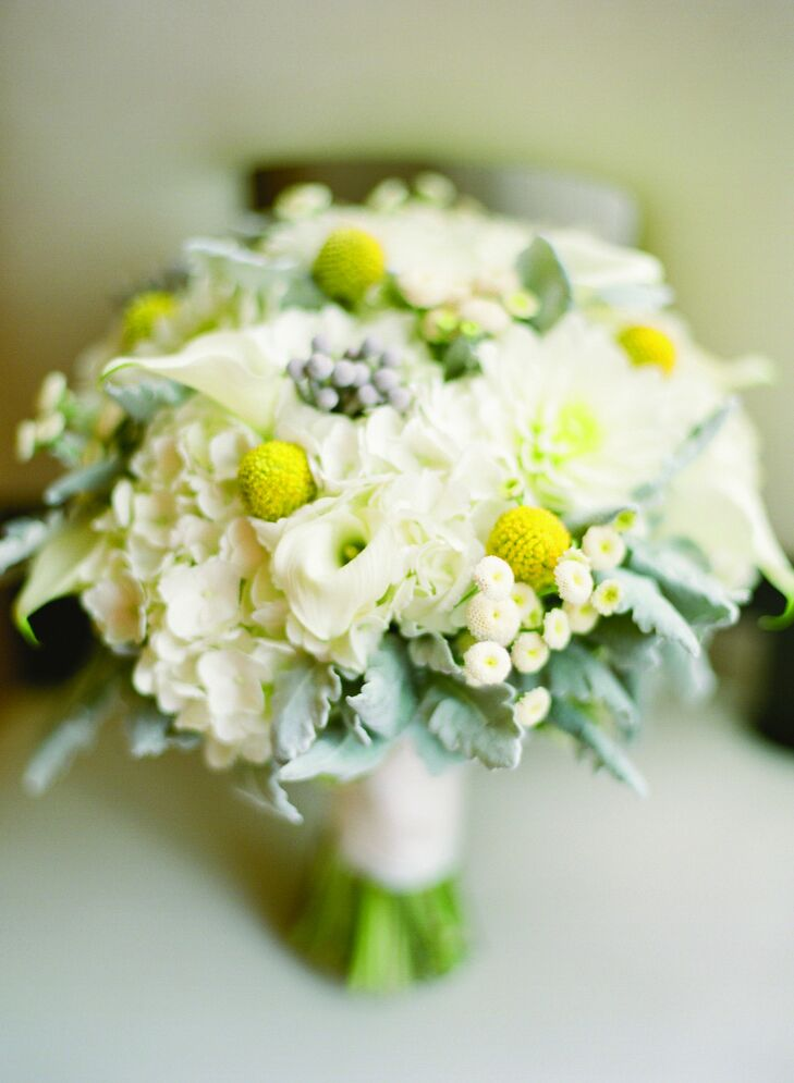 Elena's mostly white bouquet was punctuated with pops of bright-yellow craspedia.
