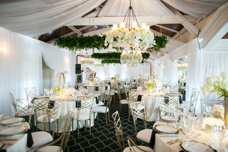 At the glamorous indoor reception, Little Hill Floral Design created a stunning floral chandelier with white hydrangeas and roses.