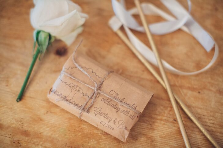 Courtney and Ben gave their guests custom-stamped brown paper parcels of coffee as wedding favors.