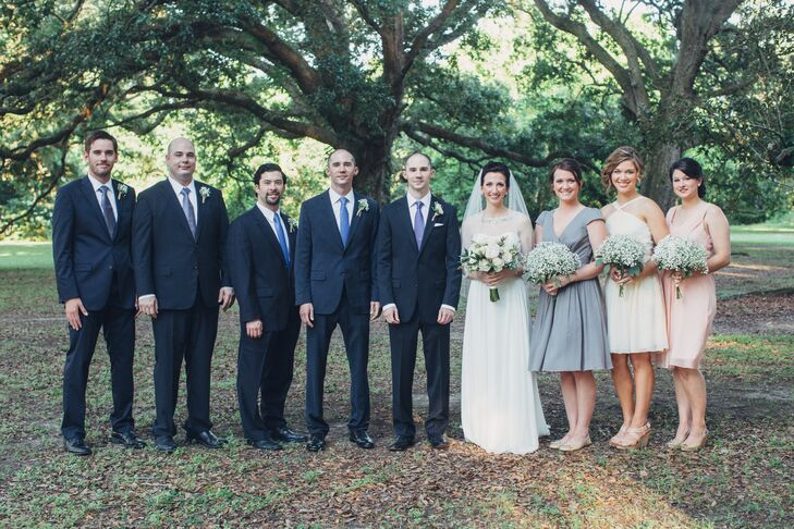 The bridesmaids each wore a different dress in the neutral color palette of gray, ivory and blush, and the groomsmen sported black suits with ties in blue hues.