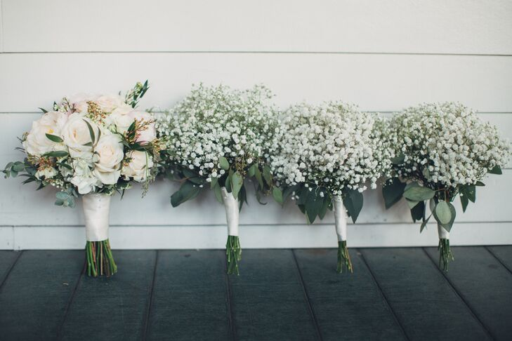 The bride's bouquet included soft blush and ivory roses and peonies with hydrangeas and pops of greens. The bridesmaids carried simple Southern-inspired bundles of baby's breath with eucalyptus greens.
