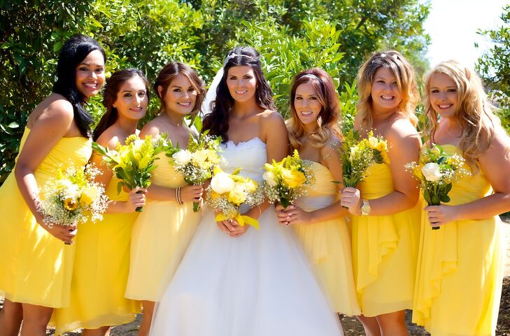 """My maid of honor and matron of honor wore canary yellow dresses while my bridesmaids wore sunbeam yellow, and both were purchased from David's Bridal,"" says Vanessa."
