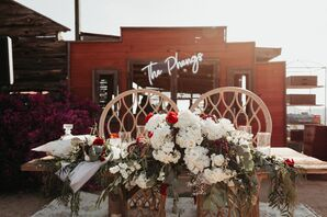 Bohemian Sweetheart Table with Chairs and Flower Arrangement
