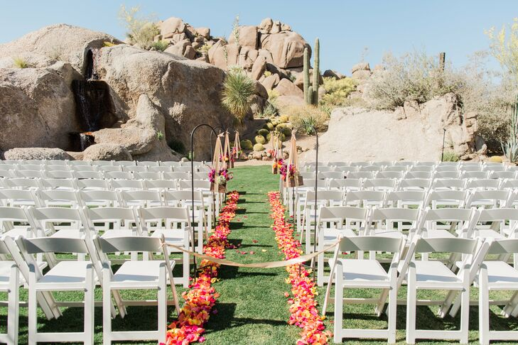 """""""I wanted our family and friends to soak in as much Arizona sunshine and desert as possible, so we took our chances and held our ceremony at Promise Rock at the Boulders Resort,"""" Kelsey says. """"We had 75-degree weather without a cloud in the sky. Perfection."""""""
