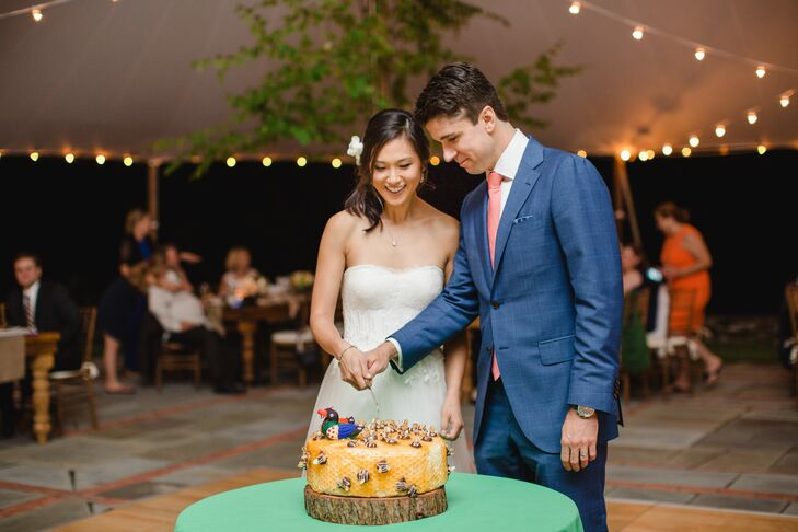 Incorporating elements that spoke to Hannah's Korean background was a given for the couple. In addition to performing a traditional paebaek ceremony the night before the wedding, Hannah and Ed decorated their wedding cake with hand-painted wooden ducks and gifted guests with hand fans specially made in South Korea.