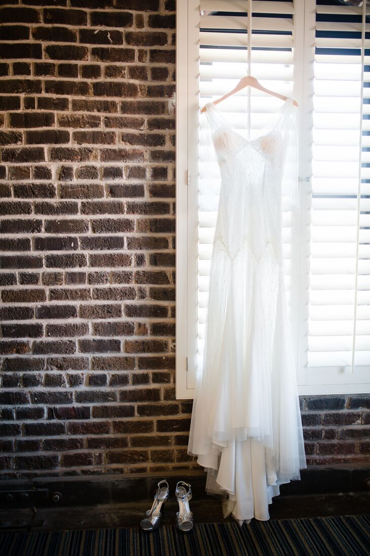 """I found a modern yet vintage-inspired Pronovias dress at Glamour Closet, and to be honest, it was the first and only one I tried on,"" says Marika. ""It was draped, beaded, and sparkly, which was perfect for our theme."""