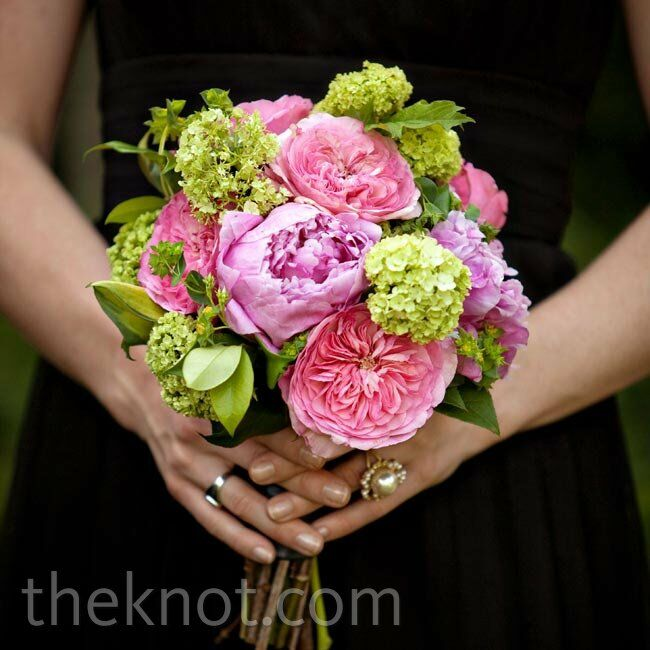 Soft arrangements of garden roses and peonies were the perfect offset to the black bridesmaid dresses.