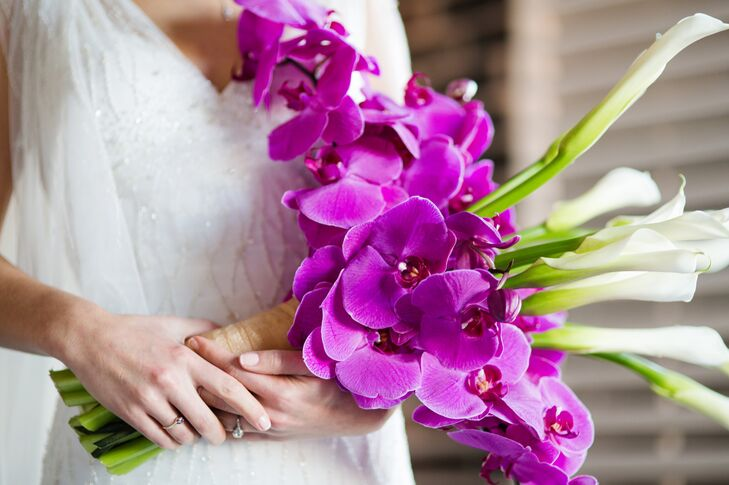 The bride held a bouquet made of purple orchids and long-stemmed calla lilies, arranged by A Simple Ceremony.