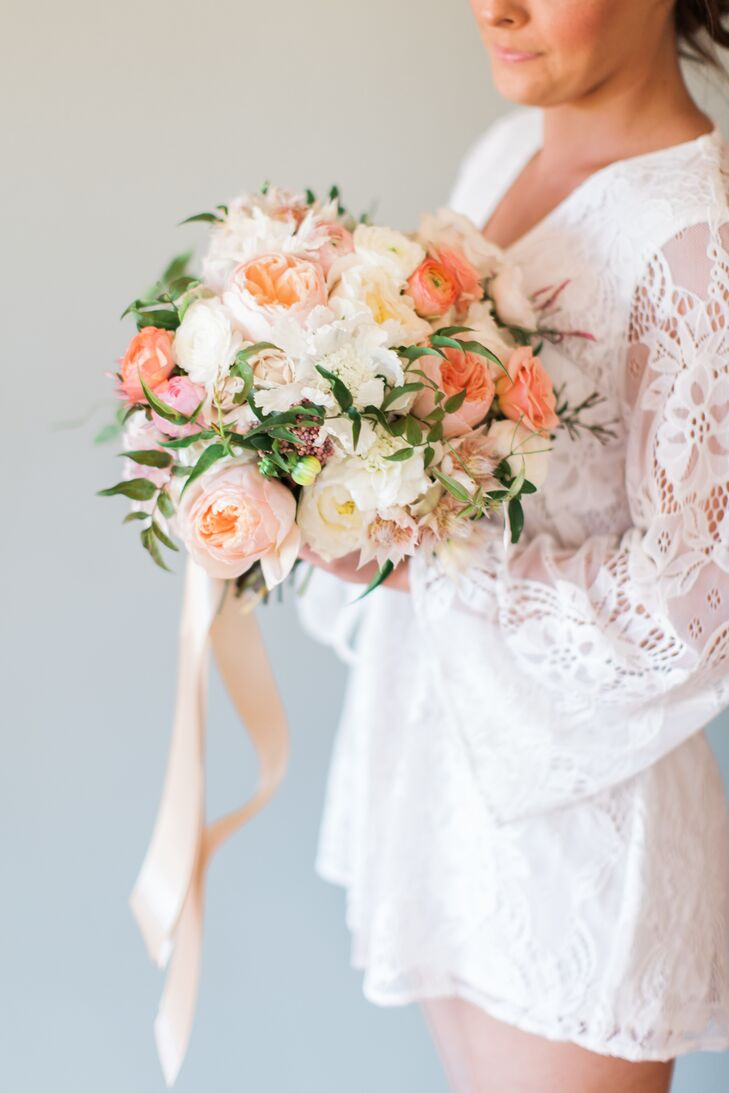 Eliza's bouquet was a bright, garden-fresh combination of cream, peach and blush peonies designed by Good Seed Floral Design of Portland, Oregon.