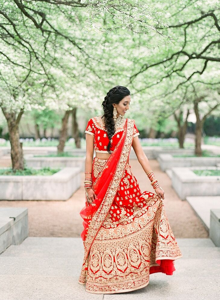 Bride with Traditional Red Lehenga, Fishtail Braid, Bracelets and Gold Earrings