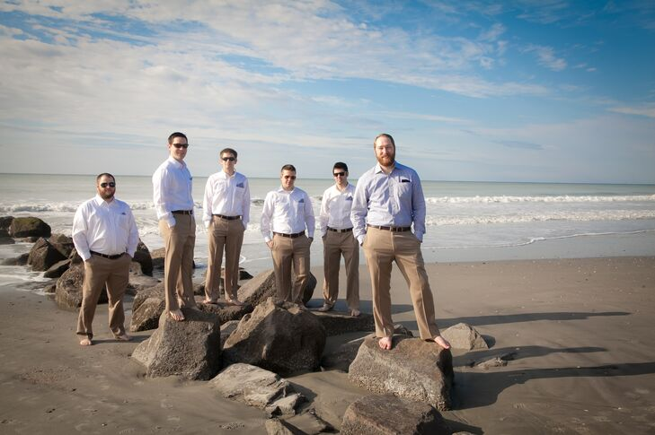 Michael and his groomsmen kept things light and casual, donning khaki trousers and white button-down shirts for the wedding. For a pop of color, they dressed up their shirt pockets with a navy gingham pocket square