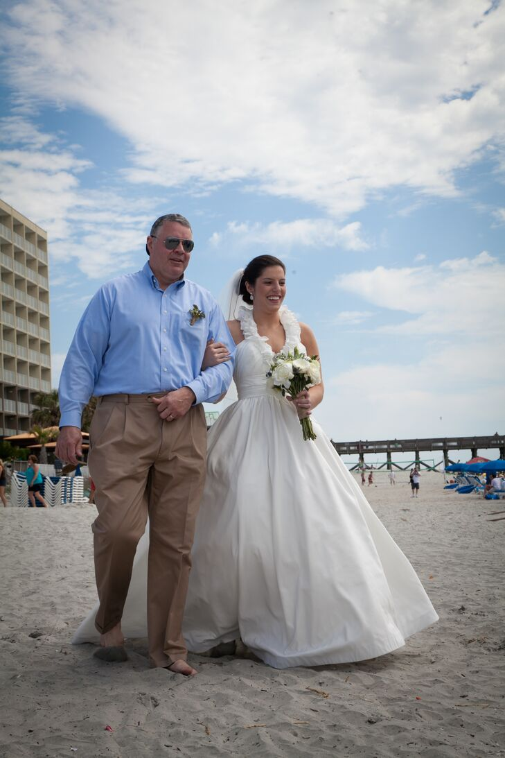Alissa's father escorted her arm-in-arm across the beach and down the aisle to the waterfront where the ceremony was to take place.