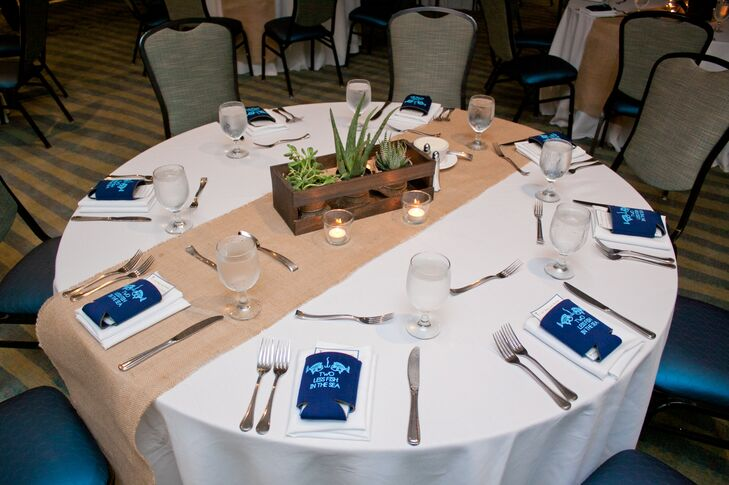 Burlap table runners, bright blue menus and understated wood and succulent centerpieces gave off a beachy vibe that worked seamlessly with the wedding's theme.