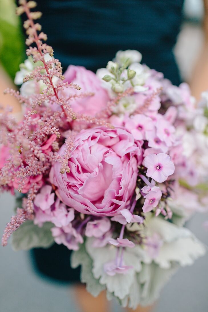 The bridesmaids carried soft pink bouquets that had large peonies complemented by tiny pink hydrangeas.
