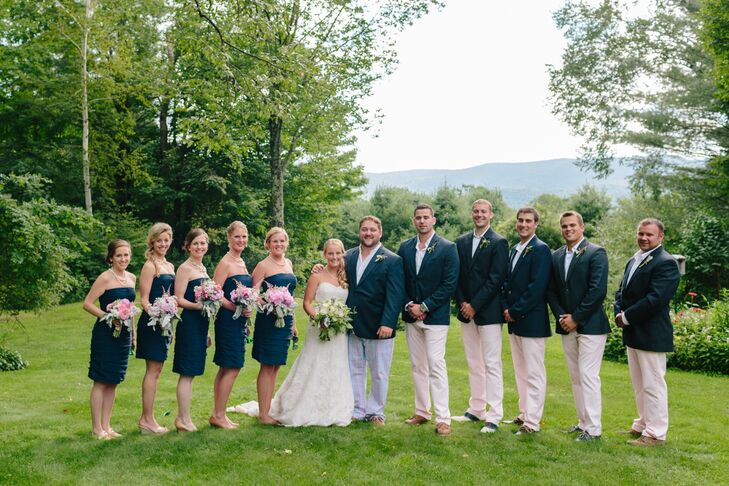 The bridesmaids wore navy cocktail dresses and the groomsmen wore vineyard vine pants and navy blazers, giving them a light a fun look for the backyard ceremony.