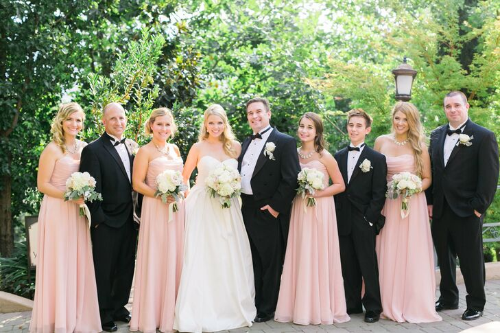 112d00ff474c While bridesmaids donned floor-length blush gowns, groomsmen sported  classic tuxedos. The groom