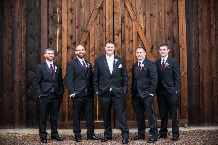 Jake's four brothers wore classic black suits with plum vests, ties and pocket squares to match the classic purple wedding theme.
