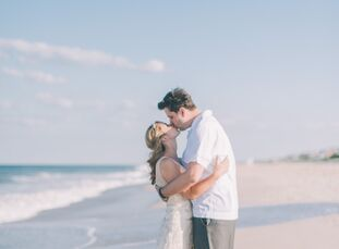 We love this glamorous waterfront wedding! Although they had their wedding at a beach house, Katie Hoehn (29 and a graphic designer) and Sean Mentus (
