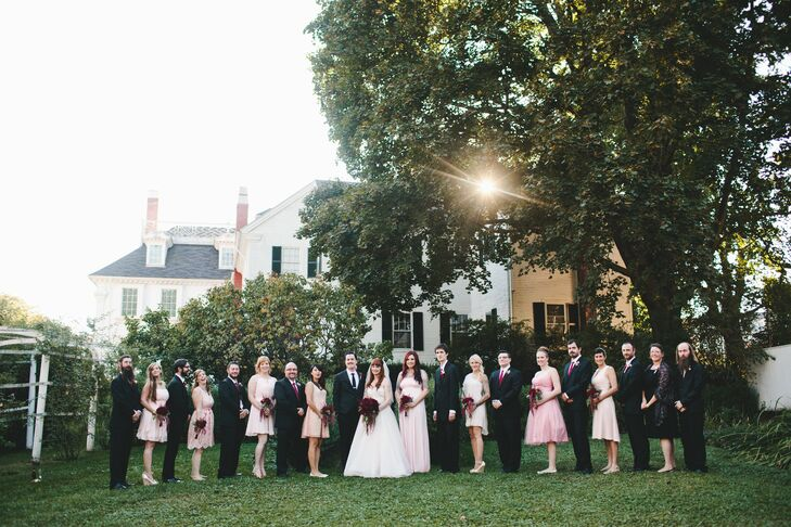 Julia asked each of her eight bridesmaids to select a short, blush pink dress in whatever style made her feel most comfortable. The groomsmen wore their own black, two-piece suits with matching slim red ties from J.Crew.