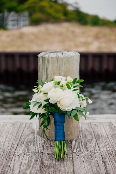 The bouquets consisted of ivory dahlias, garden roses, ranunculus, ruscus and sweet peas (in honor of Austin's nickname for Kelsey).