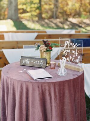 Table with Guest Book, Signs and Dusty-Rose Tablecloth