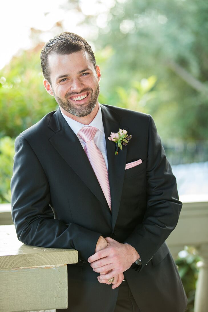 The groom wore a black Canali suit. His groomsmen wore black suits with pink ties.