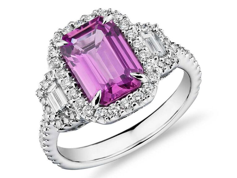 Pink sapphire engagement ring with emerald cut side stones