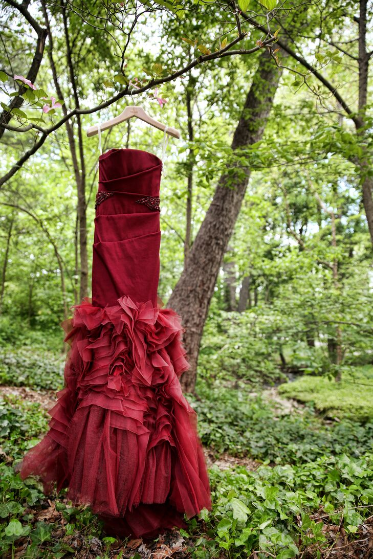 The bride wore a stunning red crimson strapless dress designed by Vera Wang on the wedding day.