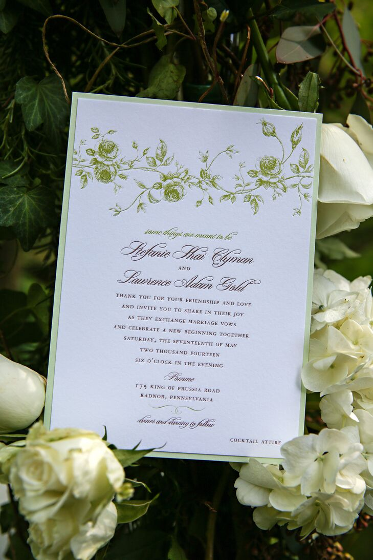 Off-white custom invitations with a sage border and vine motif had text printed in cursive, designed by La Petite Fleur.