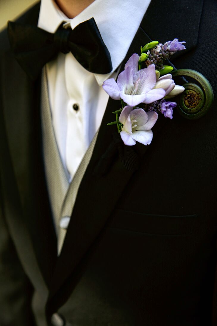 The groom's boutonniere was arranged with freesia, lavender and fiddlehead ferns,  decorated by TableArt.